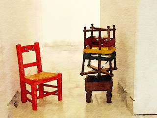Digital watercolor painting of a red mini chair with rush seat and a wooden wool spinner with red, yellow and green wool and space for text.