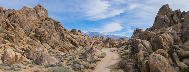 Dirt road leads into the massive boulders of California's Alabama Hills.