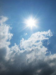 Fantastic sun and white clouds on the blue sky photo