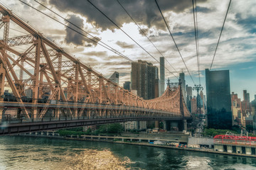 NEW YORK CITY, USA: The Queensboro Bridge is a two-level double cantilever bridge. It has two cantilever spans, one over the channel on each side of Roosevelt Island. Vivid image.