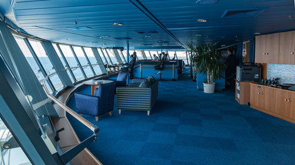 View from port wing looking towards helmsman position on bridge of  large modern passenger cruise liner. Wall mural