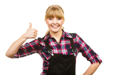 Woman in dungarees showing thumb up