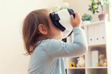 Toddler girl with virtual reality headset