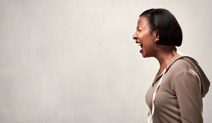 Angry screaming african american woman