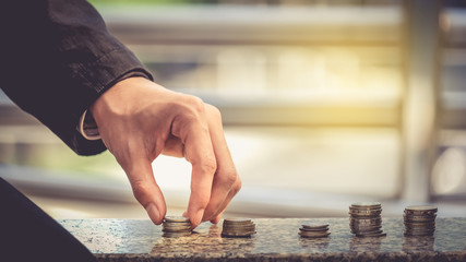 Businessmen are hand-picked collection of medals and coins. The concept of financial savings and investments in the business.