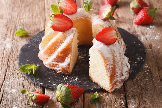 Pound Cake cake with mint and strawberry close-up. Horizontal