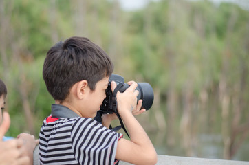 Little boy talking digital camera