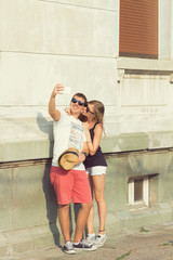 Couple in love using cellphone outdoors.