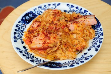 Spicy Romanian Food on a Beautifully Decorated White-Blue Plate