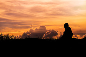 Silhouette - The Buddhist Monk Meditation and clouds evening sky