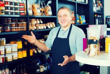 man standing near counter