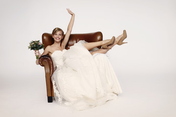 Bride in armchair smiling at camera