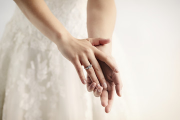 Wedding ring on bride, close up on hands