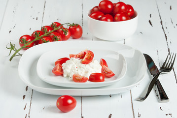 Cherry Tomatoes, Soft Cottage Cheese. White Table.