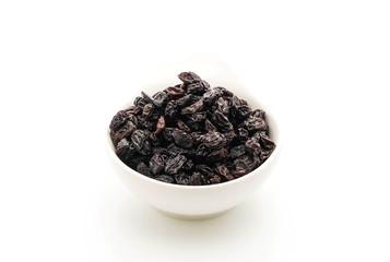 black raisins on white