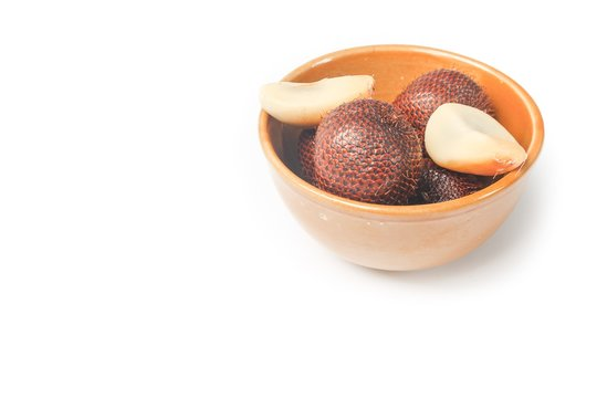Salak fruit, Salacca zalacca in cup on white background
