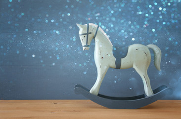 vintage rocking horse on wooden floor
