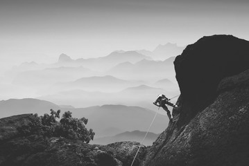 Climber against mountain valley. Black and white