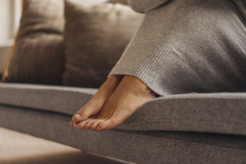 Feet of woman on couch