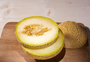 Fresh ripe melon cut on a cutting wooden board