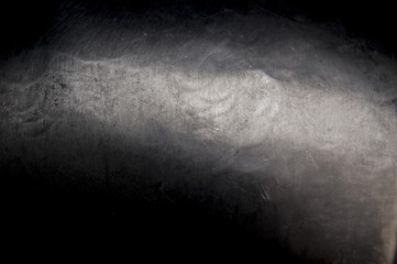 Metal background, texture of titanium, sheet of metal surface, black and grey steel