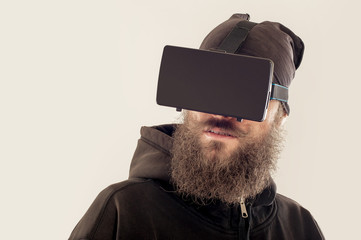 Young bearded handsome man using virtual reality device