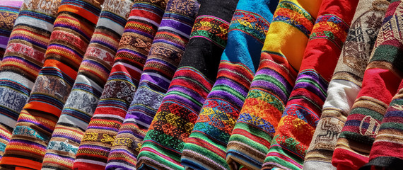 Different colorful fabric at a market in Peru