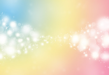 Pastel color sparkles glitter defocused rays lights bokeh abstract holiday background.