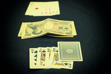 abstract scene of poker card play on japan money with vintage filter - can use to display or montage on product