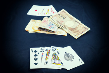 abstract scene of poker card play on japan money - can use to display or montage on product