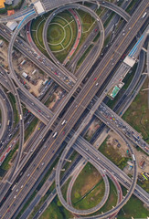 Aerial view Road roundabout. Expressway with car lots in the city in Thailand. Street large beautiful downtown. cityscape. Top view.