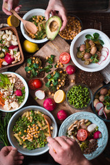 Feast with vegetable salads, fruits and sandwiches