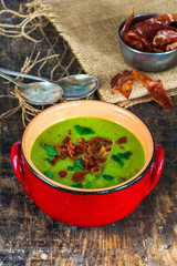 Pea and mint soup with crispy proscuitto strips