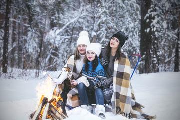 Girlfriend beautiful young women dressed warmly in winter Park