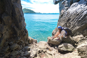 Travel women in a cave near the sea in Keo Sichang, Thailand..