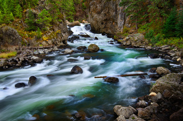 Foto op Aluminium Rivier Whitewater River Flowing Past Rocks in Wilderness