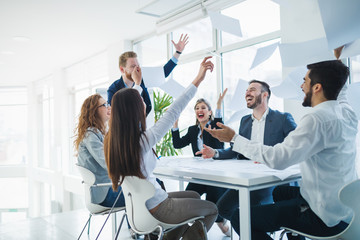 Successful business people celebrating achieved business goals