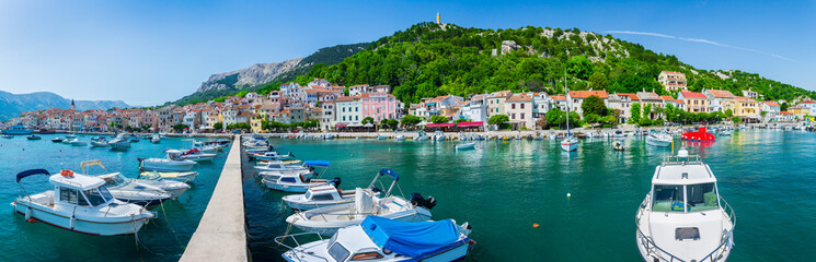 Foto auf Acrylglas Stadt am Wasser Wonderful romantic summer afternoon landscape panorama coastline Adriatic sea. Boats and yachts in harbor at cristal clear turquoise water. Baska on the island of Krk. Croatia. Europe.