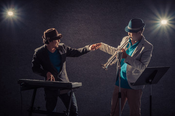 Two musician fist bump While playing music