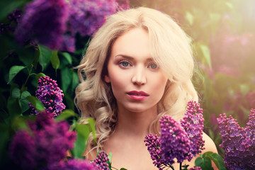 Pretty Woman with Blonde Hair Outdoors. Beautiful Model in Spring Blossom