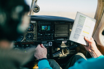 Flight instructor and student reviewing flight checklist