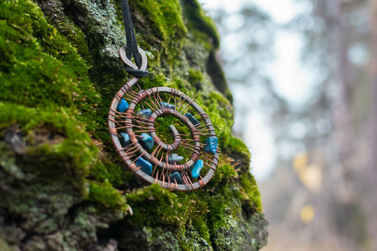 Wire wrapped jewelry in the autumn forest