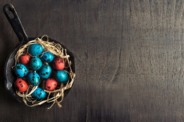 Colorful Easter eggs in the pan
