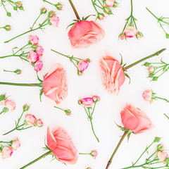 Floral pattern made of pink roses isolated on white background. Flat lay, top view. Floral background.