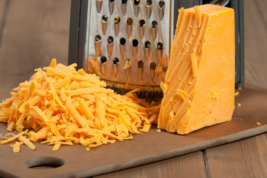 Grated Red Leicester Cheese. Grater. Cooking Ingredient.