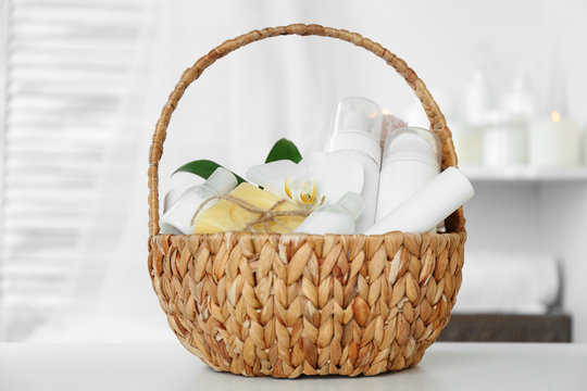 Wicker basket with spa treatments on table