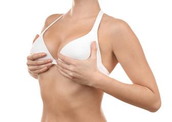 Plastic surgery concept. Woman in white bra, closeup