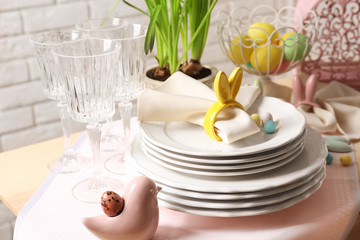 Beautiful Easter table setting with white plates