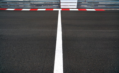 Start and Finish line in motor race asphalt Grand Prix track and guard rail or guardrail