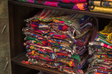 A pile of colorful rugged Peruvian textile and fabrics.